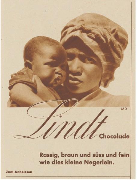 """""""Rassig braun und süss und fein wie dies kleine Negerlein"""" bewirbt Lindt 1933 ihre Schokolade. (Bild: Schweizer Illustrierte)"""